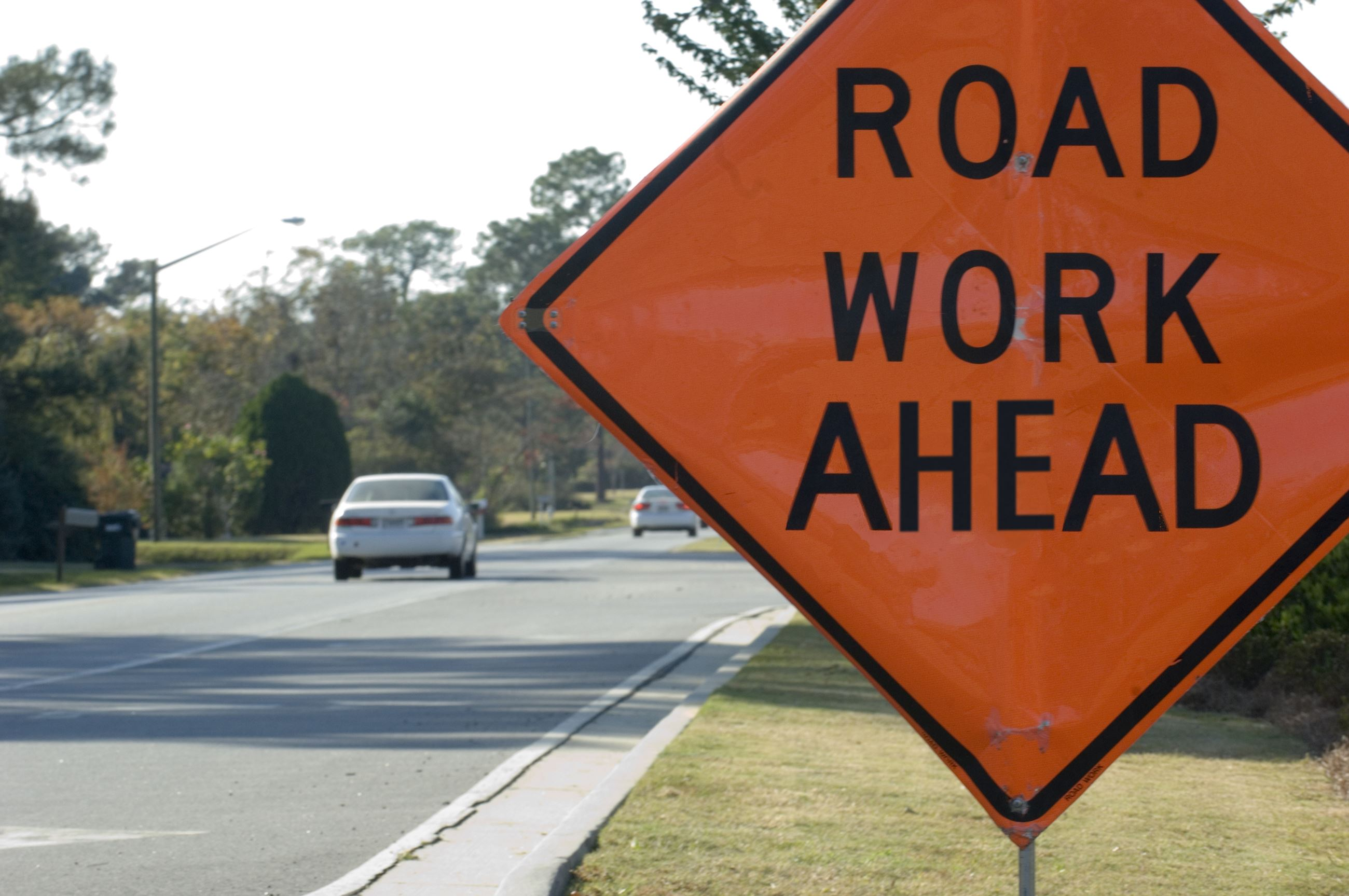Road Signage that says Road Work Ahead